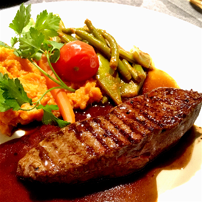 Ostrich steak with beans and mashed sweet potato